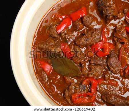 Hungarian goulash beef stew in casserole dish. - stock photo
