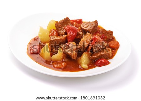 Hungarian goulash, pork stew with potatoes, isolated on white background. Foto stock ©