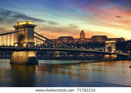 Hungarian landmarks, Chain Bridge, Royal Palace and Danube river in Budapest at sunset.