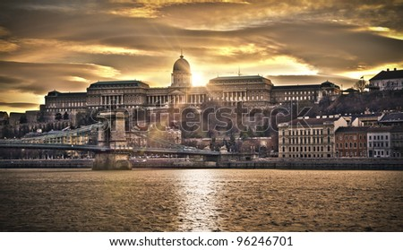 Hungarian landmarks, Chain Bridge, Royal Palace and Danube river in Budapest at sunset. HDR image.