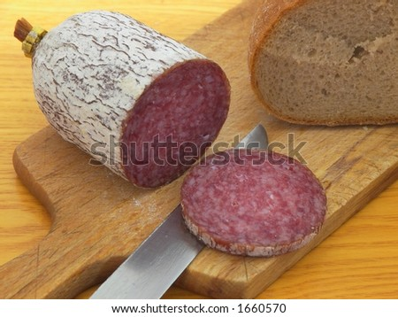 Hungarian salami, covered by thin layer of edible delicious mold.