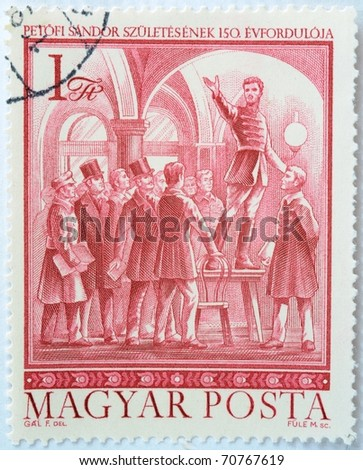 HUNGARY - CIRCA 1972: a stamp from Hungary shows image of Hungarian poet and revolutionary Sandor Petofi (1823-1849) speaking at Pilvax Cafe, circa 1972