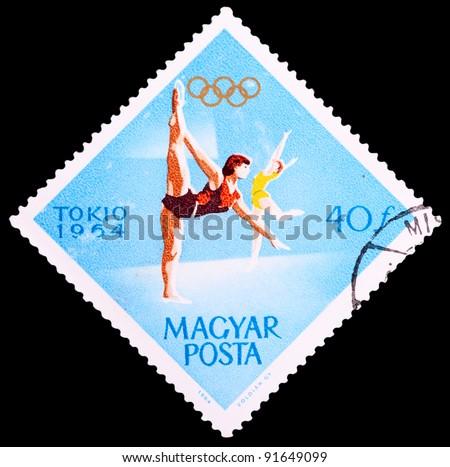 "HUNGARY - CIRCA 1964: a stamp printed by HUNGARY shows Gymnastics womenâ??s, series ""XVIII Summer Olympic Games, Tokyo, 1964"", circa 1964"