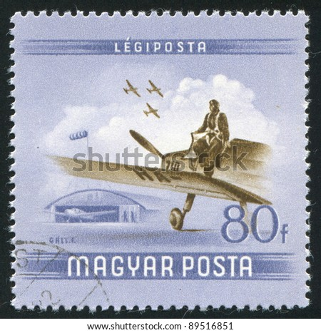 HUNGARY - CIRCA 1954: A stamp printed by Hungary, shows Pilot leaving plane, circa 1954