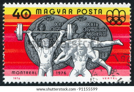 HUNGARY - CIRCA 1976: A stamp printed by Hungary, shows Weight Lifting and Wrestling, Silver medals, circa 1976 #91155599