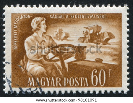 HUNGARY- CIRCA 1951: A stamp printed by Hungary, shows woman tractor operator, circa 1951