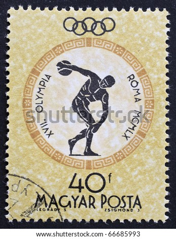 HUNGARY - CIRCA 1960: a stamp printed in Hungary celebrates Olimpic Games in Rome showing image of a discobolus. Hungary, circa 1960 - stock photo