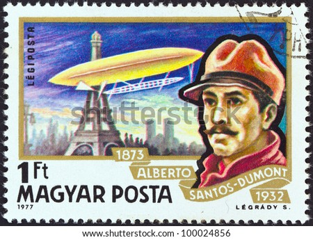 "HUNGARY - CIRCA 1977: A stamp printed in Hungary from the ""Airships"" issue shows Alberto Santos-Dumont and airship Ballon No. 5 over Paris, circa 1977."