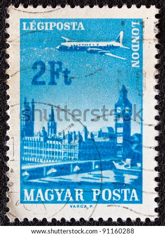 """HUNGARY - CIRCA 1966: A stamp printed in Hungary from the """"Plane over Cities served by Hungarian Airways"""" issue shows London, circa 1966."""