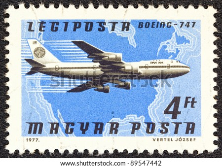 "HUNGARY - CIRCA 1977: A stamp printed in Hungary from the ""Planes, Airlines and Maps"" issue shows a Boeing 747, Pan Am and North America map, circa 1977."