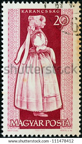 "HUNGARY - CIRCA 1963: A stamp printed in Hungary from the ""Provincial Costumes"" issue shows a woman from Karancssag, circa 1963."