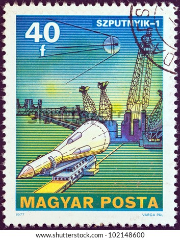 "HUNGARY - CIRCA 1977: A stamp printed in Hungary from the ""Space Research"" issue shows Sputnik 1, circa 1977."