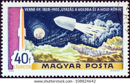 "HUNGARY - CIRCA 1969: A stamp printed in Hungary from the ""1st Man on the Moon"" 2nd issue shows Flight to the Moon (after Jules Verne), circa 1969."