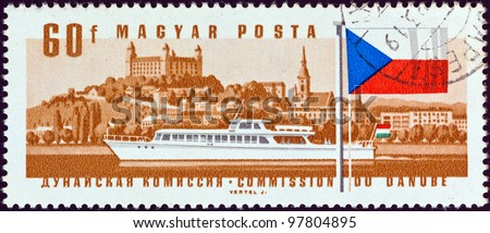 "HUNGARY - CIRCA 1967: A stamp printed in Hungary from the ""25th Session of Danube Commission"" issue shows hydro bus Revfulop and Bratislava Castle, Slovakia, circa 1967."