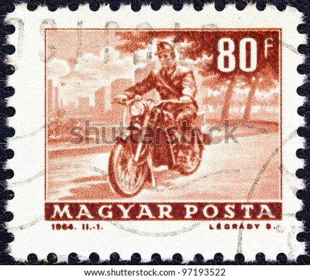 "HUNGARY - CIRCA 1963: A stamp printed in Hungary from the ""Transport and Communications"" issue shows a Motorcyclist, circa 1963."