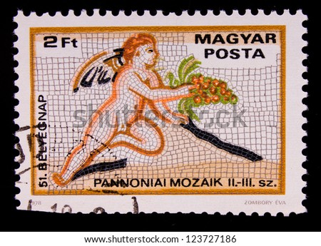 HUNGARY- CIRCA 1978: A stamp printed in Hungary shows a mosaic angel with grapes , circa 1978.