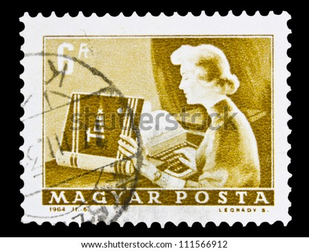 "HUNGARY - CIRCA 1964: A stamp printed in Hungary shows Girl operator and Telex, without inscription, from the series ""Transport and Telecommunication"", circa 1964."