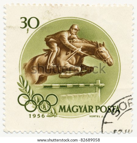 HUNGARY- CIRCA 1956: A stamp printed in Hungary shows Horse jumping hurdle, series 16th Olympic Games at Melbourne, circa 1956