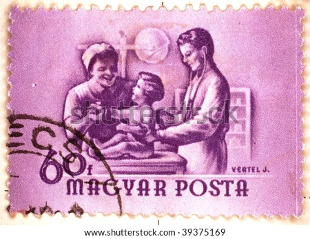 HUNGARY - CIRCA 1958: A stamp printed in Hungary shows image of nurse and doctor with a young child, series, circa 1958