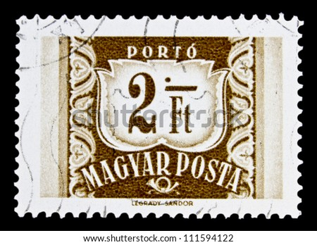 """HUNGARY - CIRCA 1958: A stamp printed in HUNGARY shows image of Post Horn and nominal with the inscription """"Porto"""", from the series """"Magyar Posta Postage Due"""", circa 1958"""