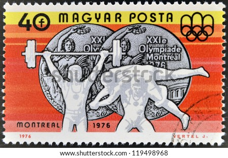 HUNGARY - CIRCA 1976: A stamp printed in Hungary shows Weight Lifting and Wrestling, Silver medals, circa 1976 #119498968