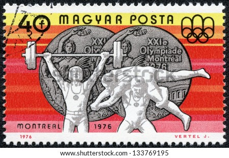 HUNGARY - CIRCA 1976: A stamp printed in Hungary shows Weight Lifting and Wrestling, Silver medals, circa 1976 #133769195