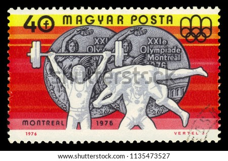 "HUNGARY - CIRCA 1976 : a stamp printed in Hungary shows weightlifting and wrestling and Olympic emblem with the inscription ""Montreal 1976"", from series ""Olympic Games in Montreal 1976"", circa 1976 #1135473527"