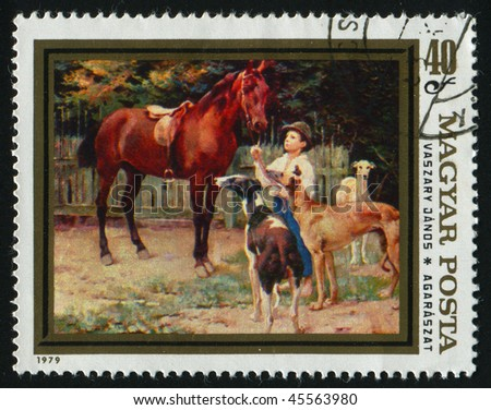 HUNGARY -CIRCA 1979: Boy with horse and greyhounds, by Lanos Vaszary, circa 1979.