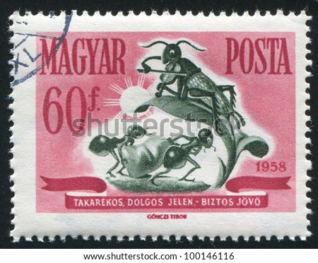 HUNGARY - CIRCA 1958: stamp printed by Hungary, shows ants mit sack and grasshopper with violin, circa 1958