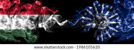 Hungary, Hungarian vs United States of America, America, US, USA, American, Buffalo, New York smoky flags side by side.  Photo stock ©