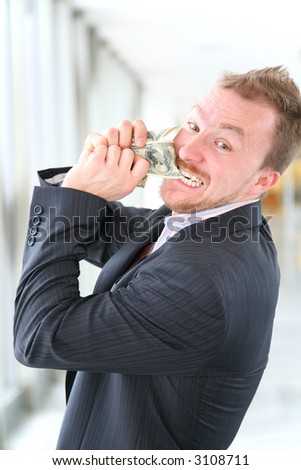hungry angry businessman with money - stock photo