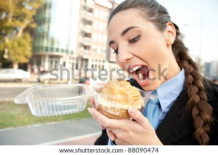 hungry  businesswoman eating donut princess, open mouth