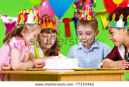 Hungry kids looking at birthday cake