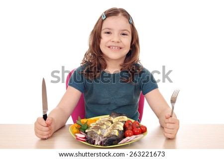 hungry little girl with fish for lunch