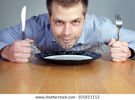 Hungry man waiting for dinner