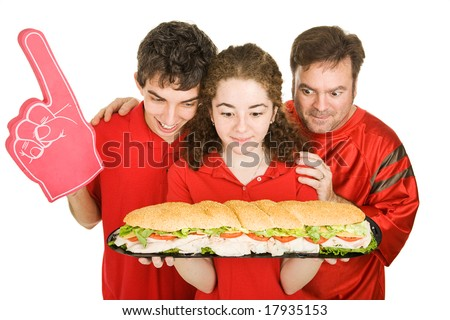 Hungry people at a football party, looking at a giant submarine sandwich.  Isolated on white.
