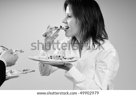 hungry woman eating pizza