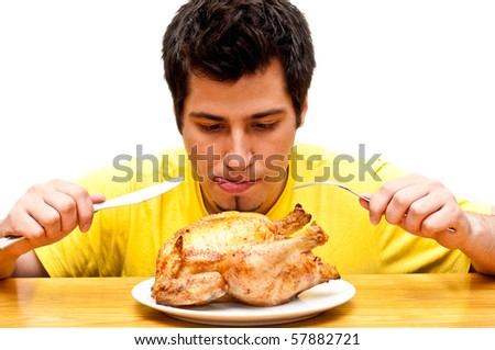 hungry young man waiting to eat freshly roasted whole chicken