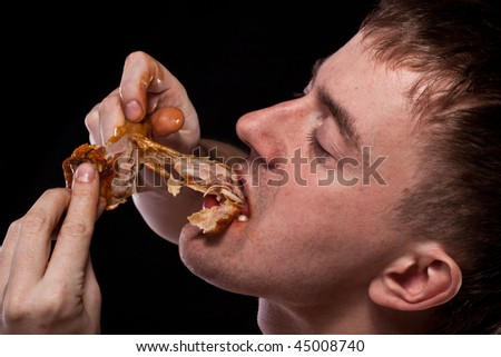 Hungy man eating chicken