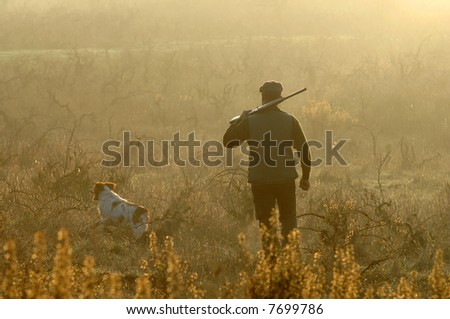 hunter and his dog looking for small game