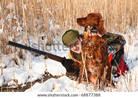 Hunter and his dog waiting for the hunt to show. Trained dog waiting to retrieve the prey