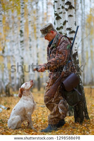 Hunter and hunters dog. Hunting. Hunting dog. Pointing dog. Portrait of partridges on the hunt. Russia autumn landscape. #1298588698