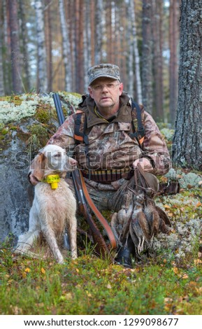 Hunter and hunting dog. Hunting. Hunters dog. English setter. Portrait with trophies. Pointing dog. Hunting woodcock. #1299098677