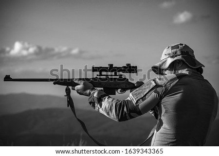 Hunter Classic. Hunter with shotgun gun on hunt. Hunter in the hunting season. Hunting period. Male with a gun. Hunter with hunting gun and hunting form to hunt