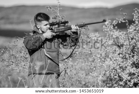 Hunter hold rifle. Hunting permit. Bearded hunter spend leisure hunting. Hunting equipment for professionals. Hunting is brutal masculine hobby. Man aiming target nature background. Aiming skills. #1453651019