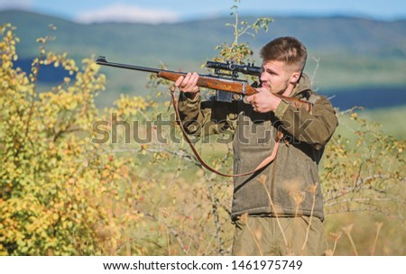 Hunter hold rifle. Hunting permit. Bearded hunter spend leisure hunting. Hunting equipment for professionals. Hunting is brutal masculine hobby. Man aiming target nature background. Aiming skills. #1461975749