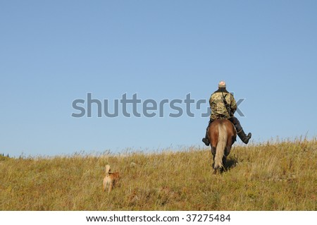 Hunter in the way - stock photo