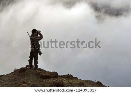 hunter looking for game animals such as chamois, deer or tahr, in  South Westland's Southern Alps, New Zealand Stockfoto ©
