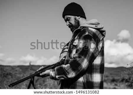 Hunter spend leisure hunting. Hunting equipment for professionals. Hunting is brutal masculine hobby for hunters