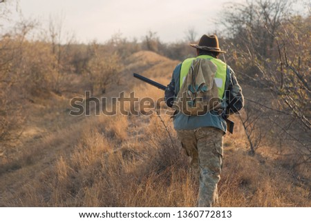 Hunter with a german drathaar and spaniel, pigeon hunting with dogs in reflective vests